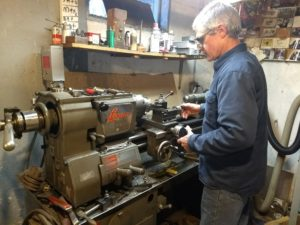 George machining a part for a Judson supercharger